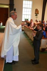 Click to view album: First Communion 5-14-2016 10AM Mass